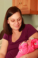 The first baby born in the area was a girl, Kailynn Stoltz at 1:33 a.m.  Her parents are Ashley Martin (pictured) and Craig Stoltz of  Dayton, photographed in their room at the Miami Valley Hospital's Berry Building, Tuesday, January 1, 2013.
