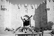 JERUSALEM:  a palestinian boy from the association 'Parkour Jerusalem' performs in front of Damascus gate, in the Old City. Copyright Christian Minelli Copyright Christian Minelli