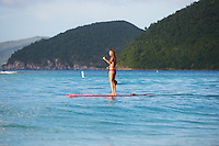 Beautiful paddleboarder on the water of Cinnamon bay beach St. John, USVI.