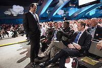 SAN FRANCISCO, CA - DEC 7:  Marc Benioff, Chairman & CEO of salesforce.com listens as Black Eyed Peas front man will.i.am speaks during a keynote speech during the 2010 DreamForce Global Gathering being held at the Moscone Center on December 7, 2010 in San Francisco, California.  Photography by David Paul Morris