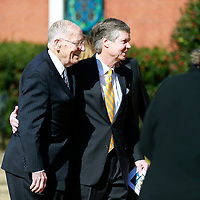 Thomas Wells | BUY AT PHOTOS.DJOURNAL.COM<br /> Former Gov. William Winter, left, walk into First United Church with Jack Reed Jr. and the rest of the Reed family before the funeral service for Jack Reed Sr. on Saturday.