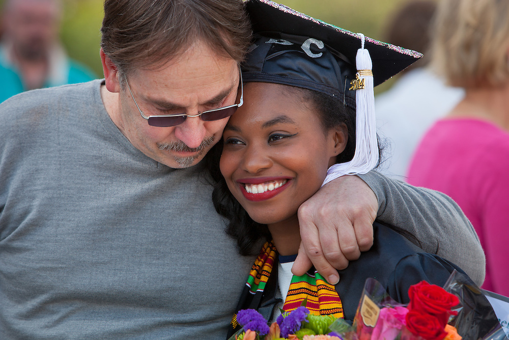 Michael Ciraky gives Alexandria Cooke a hug after Ohio University Commencement ceremony Saturday May 3, 2014.  Ciraky had driven her to Athens, Ohio for her first visit to the campus four years ago from Solon Ohio, near Cleveland.  Photo by Ohio University / Jonathan Adams