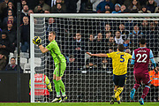 Bernd Leno (GK) (Arsenal) saves the ball during the Premier League match between West Ham United and Arsenal at the London Stadium, London, England on 9 December 2019.
