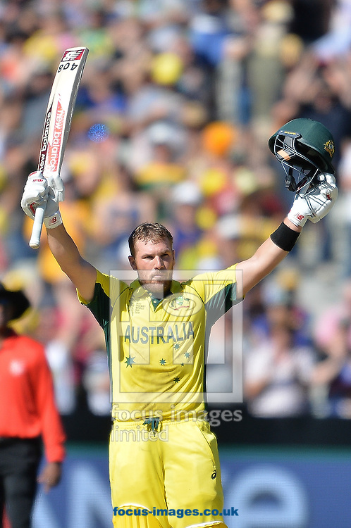 Aaron Finch of Australia celebrates after reaching his century during the 2015 ICC Cricket World Cup match at Melbourne Cricket Ground, Melbourne<br /> Picture by Frank Khamees/Focus Images Ltd +61 431 119 134<br /> 14/02/2015