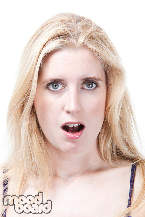 Portrait of surprised young Caucasian woman against white background
