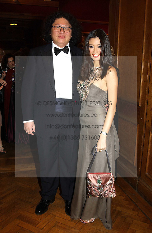 MISS REBECCA WANG and her brother BRUNO WANG at a Royal Gala dinner attended by TRH Prince & Princess Michael of Kent in aid of the British Red Cross and titled 'Jewels for Life', held at Christie's, St.James's, London on 1st December 2003.