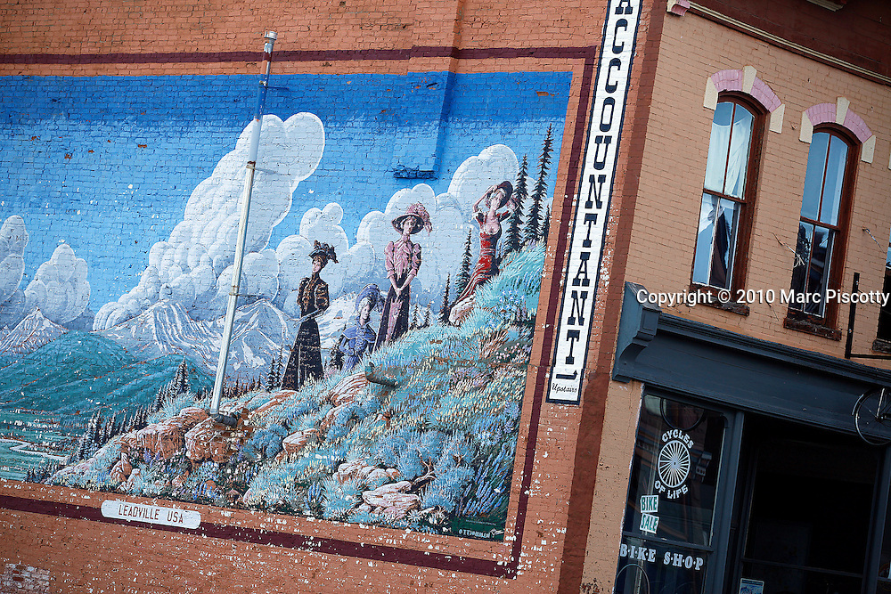 SHOT 6/20/10 6:38:56 PM - A mural on the side of a building in Leadville, Colorado depicting a mountain scene. Leadville is the county seat of, and the only municipality in, Lake County, Colorado, United States. Situated at an elevation of 10,152 feet (3094 m), Leadville is the highest incorporated city and the second highest incorporated municipality in the United States. A former silver mining town that lies near the headwaters of the Arkansas River in the heart of the Rocky Mountains, the city includes the Leadville Historic District, which preserves many historic structures and sites from Leadville's dynamic mining era. In the late 1800s, Leadville was the second most populous city in Colorado, after Denver. The United States Census Bureau estimates that the city population has shrunk to only 2,688 in 2005. (Photo by Marc Piscotty / © 2010)