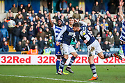 Millwall forward Tom Bradshaw (9) heads towards goal during the EFL Sky Bet Championship match between Millwall and Reading at The Den, London, England on 18 January 2020.