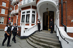 © Licensed to London News Pictures. 15/08/2012. Police outside the Ecuadorian embassy in London where Julian Assange is currently residing on August 15, 2012 in an attempt to gain political asylum in Equador in order to avoid  extradition to Sweeden where he is due to face charges of rape. Ecuador's president Rafael Correa is expected to make a decision on the asylum of Julian Assange this week.  Photo credit : Ben Cawthra/LNP