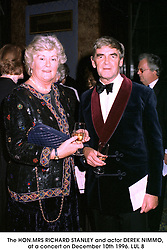 The HON.MRS RICHARD STANLEY and actor DEREK NIMMO, at a concert on December 10th 1996.LUL 8