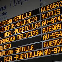 Electronic departures board inside of a train station, Estación de Atocha, Madrid, Spain, Europe.