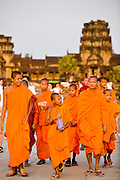19 MARCH 2006 - SIEM REAP, SIEM REAP, CAMBODIA: Buddhist monks leave the Angkor Wat complex near Siem Reap, Cambodia. More than one million tourists are expected to visit Angkor in 2006 and it is the largest tourist attraction in Cambodia. It is also still one of the most important centers of Buddhism in Cambodia. PHOTO BY JACK KURTZ