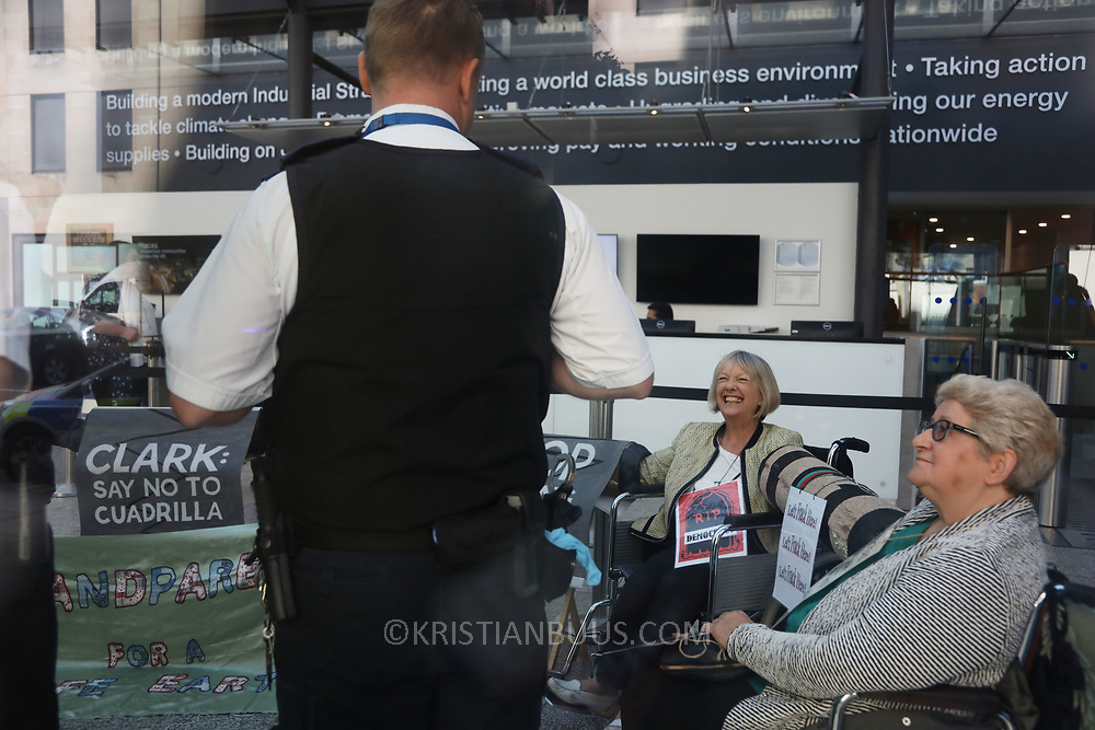 A group of grandparents and elders have chained themselves together in a government department building in Westminster to urge the government to oppose &ldquo;dangerous&rdquo; fracking June 13th 2018, Central London, United Kingdom.<br /> <br /> Aged between 63 and 82, the 10-strong group from the South West - Grandparents for a Safe Earth (GFASE) - have occupied the Westminster building to demand that the Secretary of State for the Department for Business, Energy and Industrial Strategy Greg Clark refuse permission for fracking.
