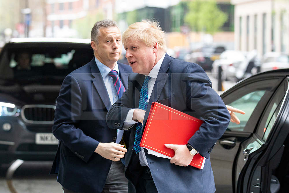 © Licensed to London News Pictures. Foreign Secretary BORIS JOHNSON (R) arrives at BBC Broadcasting House to appear on the Andrew Marr Show. 15/04/2018. London, UK. Photo credit: Rob Pinney/LNP