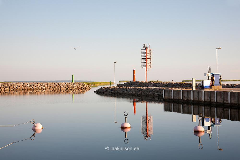 Gas station in Kuressaare Marina, Estonia. Buoys. Stony pier on background.