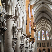 Main hall of the Cathedral of St. Michael and St. Gudula (in French, Co-Cathédrale collégiale des Ss-Michel et Gudule). A church was founded on this site in the 11th century but the current building dates to the 13th to 15th centuries. The Roman Catholic cathedral is the venue for many state functions such as coronations, royal weddings, and state funerals. It has two patron saints, St Michael and St Gudula, both of whom are also the patron saints of Brussels.