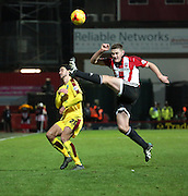 Brentford defender Jack O'Connell cleaing ball after another Burnley attack during the Sky Bet Championship match between Brentford and Burnley at Griffin Park, London, England on 15 January 2016. Photo by Matthew Redman.