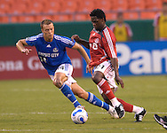 July 1, 2007 - Kansas City, MO..Toronto FC midfileder Collin Samuel #21 drives against Kansas City Wizards defender Jack Jewsbury #14 in the second half at Arrowhead Stadium in Kansas City, Missouri on July 1, 2007...MLS:  The Toronto FC and the Wizards finished with a 1-1 tie.  Photo by Peter G. Aiken / Cal Sport Media