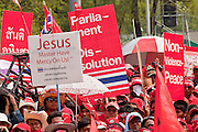 """Mar. 27, 2010 - BANGKOK, THAILAND:  A Red Shirt sign asks for help from Jesus during the Red Shirts' protest in Bangkok. Fewer than 5% of the population is Christian in this overwhelmingly Buddhist country. More than 80,000 members of the United Front of Democracy Against Dictatorship (UDD), also known as the """"Red Shirts"""" and their supporters marched through central Bangkok March 27 during a series of protests against and demand the resignation of current Thai Prime Minister Abhisit Vejjajiva and his government. The protest is a continuation of protests the Red Shirts have been holding across Thailand. They support former Prime Minister Thaksin Shinawatra, who was deposed in a coup in 2006 and went into exile rather than go to prison after being convicted on corruption charges. Thaksin is still enormously popular in rural Thailand.    PHOTO BY JACK KURTZ"""