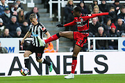 Matt Ritchie (#11) of Newcastle United controls the long pass ahead of Terence Kongolo (#5) of Huddersfield Town during the Premier League match between Newcastle United and Huddersfield Town at St. James's Park, Newcastle, England on 31 March 2018. Picture by Craig Doyle.
