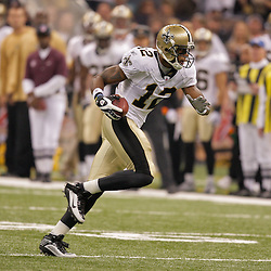 2009 October 18: New Orleans Saints wide receiver Marques Colston (12) runs after a catch during a 48-27 win by the New Orleans Saints over the New York Giants at the Louisiana Superdome in New Orleans, Louisiana.