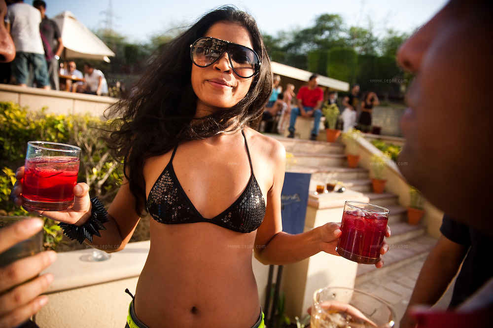 A young Indian model enjoys a sunday afternoon by the pool at the Grand, New Delhi