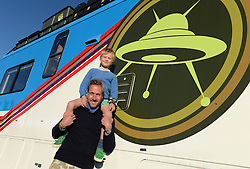 EDITORIAL USE ONLY<br /> Television presenter Ben Fogle and his son Ludo, six, launch Cartoon Network's Rust Bucket competition in partnership with Airbnb, for families to win a night's stay in a real-life replica of the motorhome that features in the animated series Ben 10, which returns to screens on Saturday 8th October at 10am.