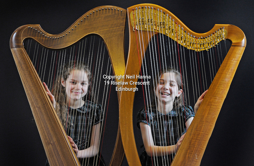 JP License<br /> <br /> Edinburgh International Harp Festival 1-6th April 2016.<br /> <br /> Brigitte and Clara Harrigan Lees.<br /> Age 9.<br /> Started learning harp at age 6.<br /> Study harp with Helen MacLeod at St Mary&rsquo;s Music School, where they are choristers.<br /> This is their 3rd year at the EIHF.<br /> They are participating in one of the harp courses and will attend various concerts at the festival.<br /> <br />  Neil Hanna Photography<br /> www.neilhannaphotography.co.uk<br /> 07702 246823