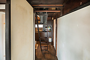 Oiso, Kanagawa prefecture, Japan, February 10 2017 - Keiji and Atsuko Suzuki's minka, traditional wooden house, is the last minka home in Oiso. The previous owner of the 3,000 sq. ft. house moved it from the shores of Lake Biwa, near Kyoto, 35 years ago.<br /> Up to the attic room.