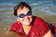 Woman swimming in Bariay, Holguin, Cuba.