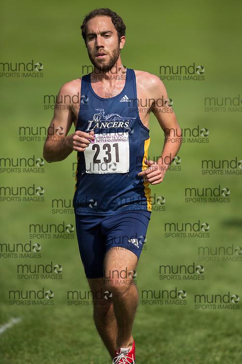 Paul Lamarra of the Windsor Lancers runs at the 2014 Western International Cross country meet in London Ontario, Saturday,  September 20, 2014.<br /> Mundo Sport Images/ Geoff Robins