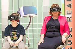 Cabinet Secretary for Culture, Tourism and External Affairs, Fiona Hyslop visits one of the highlights of the annual Edinburgh International Science Festival, Play On at the National Museum of Scotland. Play On is a family-friendly, interactive exhibition which is divided into four zones (Game Theory, Make Some Noise, Toy Box and Picture This) and explores how technology influences our leisure time.<br />  <br /> Ms Hyslop met with the Science Festival's Directors, Simon Gage and Amanda Tyndall, as well as the artists and designers behind the Play On.<br /> <br /> Pictured: Fiona Hyslop using a Virtual Reality headset with Ben Burnet (Aged 10)