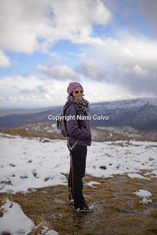 Portrait of young woman in snowy mountain