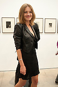 NATALIA VODIANOVA, Jake or Dinos Chapman, White Cube, Mason's Yard and afterwards at The Tab Centre, Austin Street, London E2. 14 July 2011. <br /> <br />  , -DO NOT ARCHIVE-© Copyright Photograph by Dafydd Jones. 248 Clapham Rd. London SW9 0PZ. Tel 0207 820 0771. www.dafjones.com.