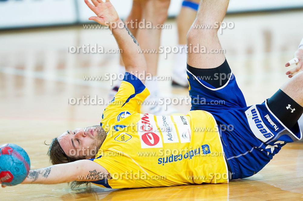 Dean Bombac of Koper during handball match between RK Cimos Koper and RK Celje Pivovarna Lasko in 26th Round of 1st NLB Leasing league 2012/13 on April 14, 2013 in Arena Bonifika, Koper, Slovenia. (Photo By Vid Ponikvar / Sportida)
