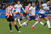 James Rowe puts in the cross that leads to CTFC's opening goal from Danny Wright during the Vanarama National League match between Barrow and Cheltenham Town at Holker Street, Barrow, United Kingdom on 6 February 2016. Photo by Antony Thompson.