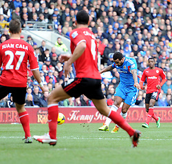 Hull City's Tom Huddlestone scores the first goal of the game. - Photo mandatory by-line: Alex James/JMP - Tel: Mobile: 07966 386802 22/02/2014 - SPORT - FOOTBALL - Cardiff - Cardiff City Stadium - Cardiff City v Hull City - Barclays Premier League
