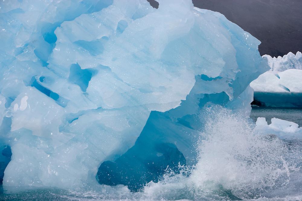 Antarctica, South Georgia Island (UK), Morning sun lights blue icebergs from Neumayaer Glacier in Cumberland West Bay