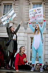 © Licensed to London News Pictures. 15/02/2019. London, UK. Young people demonstrate against climate change in Whitehall, as part of the group 'Youth Strike 4 Climate'. Many children across the UK today walked out of school as part of a global campaign calling for action over climate change. Photo credit : Tom Nicholson/LNP