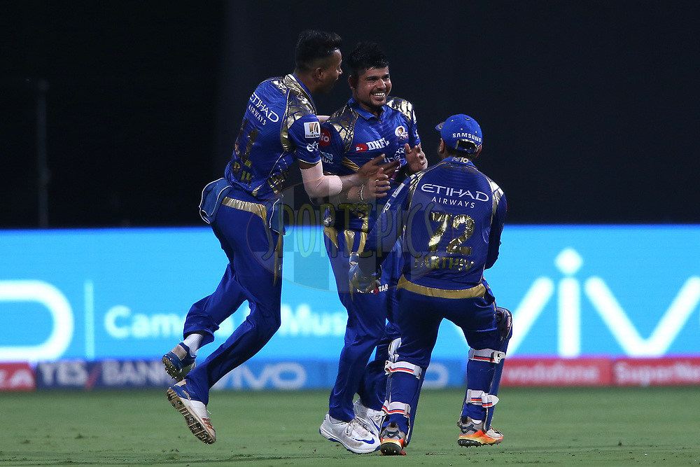 Karn Sharma of the Mumbai Indians is congratulated by Hardik Pandya of the Mumbai Indians and Parthiv Patel of the Mumbai Indians for getting Colin de Grandhomme of the Kolkata Knight Riders wicket during the 2nd qualifier match of the Vivo 2017 Indian Premier League between the Mumbai Indians and the Kolkata Knight Riders held at the M.Chinnaswamy Stadium in Bangalore, India on the 19th May 2017<br /> <br /> Photo by Shaun Roy - Sportzpics - IPL