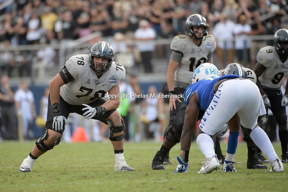 Central Florida offensive lineman Wyatt Miller (78) sets up to block during the second half of the American Athletic Conference championship NCAA college football game against Memphis Saturday, Dec. 2, 2017, in Orlando, Fla. Central Florida won 62-55. (Photo by Phelan M. Ebenhack)