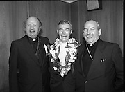 "Fr Niall O'Brien Returns from Captivity.1984..14.07.1984..07.14.1984..On 6 May 1983,Fr Niall O'Brien was arrested along with two other priests, Fr. Brian Gore, an Australian, Fr. Vicente Dangan, a Filipino and six lay workers - the so-called ""Negros Nine"", for the murders of Mayor Pablo Sola of Kabankalan and four companions. The priests where held under house arrest for eight months but ""escaped"" to prison in Bacolod City, the provincial capital, where they felt they would be safer.The case received widespread publicity in Ireland and Australia, the home of one of the co-accused priests, Fr. Brian Gore. When Ronald Reagan visited Ireland in 1984, he was asked on Irish TV how he could help the missionary priest's situation. A phone call the next day from the Reagan administration to Ferdinand Marcos resulted in Marcos offering a pardon to Fr. O'Brien and his co-accused..(Ref Wikipedia)...Bishop Eamon Casey and Cardinal O'Fiach share a joke with Fr Niall in the VIP lounge at Dublin Airport."