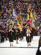 Flag bearers process into Camp Randall Stadium during the University of Wisconsin-Madison commencement ceremony, Saturday, May 17, 2014.