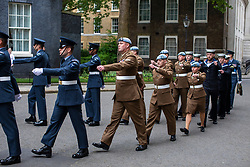 © Licensed to London News Pictures. 23/05/2018. London, UK. Members of the armed forces march along Downing Street as part of the RAF100 Centenary celebrations. Photo credit: Rob Pinney/LNP
