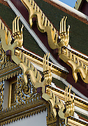 Golden ornaments line the roof eaves of Dusit Maha Prasat throne hall, built by King Rama I in 1790 in Bangkok, Thailand, Asia.