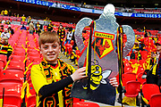 A young Watford fan with a cut out FA Cup before the The FA Cup Final match between Manchester City and Watford at Wembley Stadium, London, England on 18 May 2019.