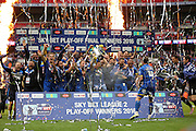 AFC Wimbledon defender Barry Fuller (2) lifts the trophy after winning during the Sky Bet League 2 play off final match between AFC Wimbledon and Plymouth Argyle at Wembley Stadium, London, England on 30 May 2016.