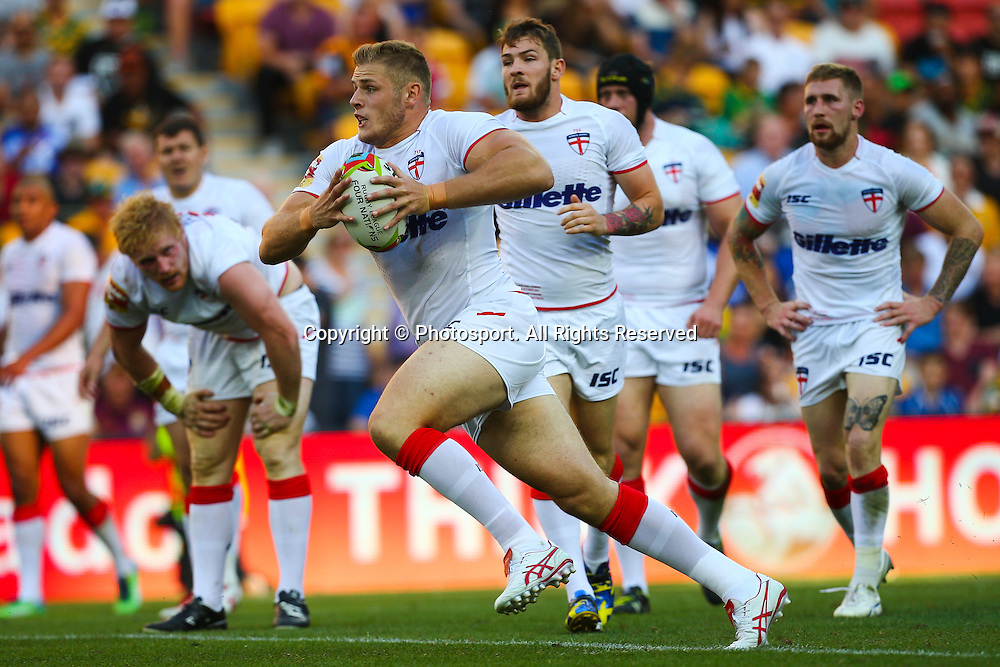 Tom Burgess runs at the Samoa defence during the Four Nations test match between England and Samoa at Suncorp Stadium,  Brisbane Australia on October 18, 2014.