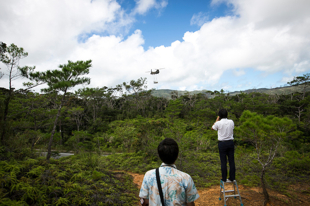 OKINAWA, JAPAN - SEPTEMBER 13 : Local media takes photos of Japan Air Self-Defense Force helicopter Boeing CH-47 after lifting a truck inside of the on going helipads construction in a restricted area of U.S. military's Northern Training Area in the village of Higashi, Okinawa Prefecture, Japan on September 13, 2016. Japanese government uses Japan Self-Defense Forces to help speed up the completion of total six helipads to be use by U.S Military. (Photo by Richard Atrero de Guzman/NURPhoto)