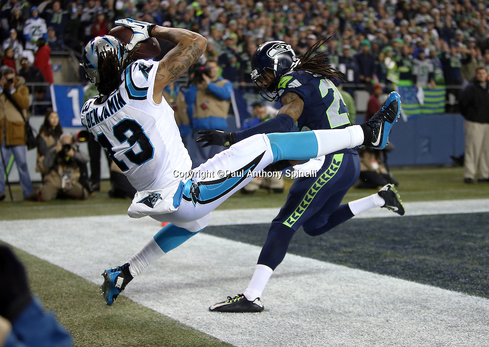 Carolina Panthers wide receiver Kelvin Benjamin (13) is covered by Seattle Seahawks cornerback Richard Sherman (25) as he catches an end zone pass subsequently ruled out of bounds late in the second quarter during the NFL week 19 NFC Divisional Playoff football game against the Seattle Seahawks on Saturday, Jan. 10, 2015 in Seattle. The Seahawks won the game 31-17. ©Paul Anthony Spinelli